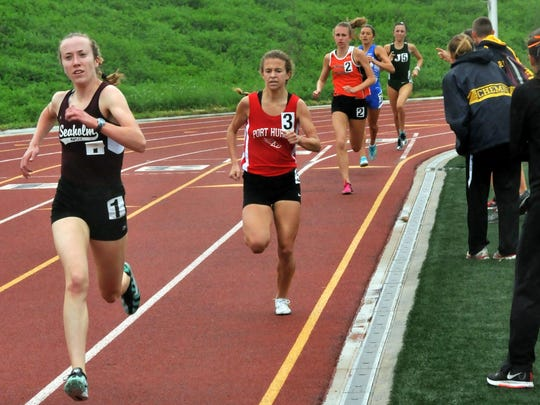 Port Huron's Rachel Bonner (middle) runs Saturday in the girls 1,600 meters at the Division 1 state finals in Rockford. Bonner placed second with a personal best and school record time of 4:49.68, which would have been the top time in any other division.