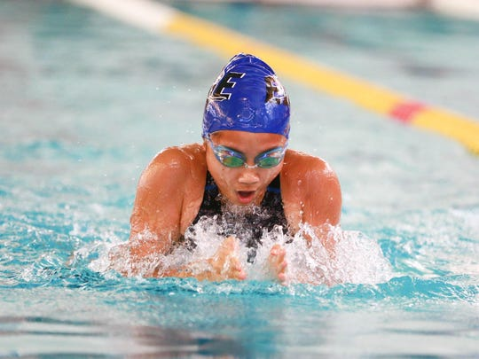 Kimberly Nguyen swims the 50-yard breaststroke leg of the record-breaking EDGE medley relay at the Vermont Swim Association state championships meet on Saturday at the Upper Valley Aquatic Center in White River Junction.