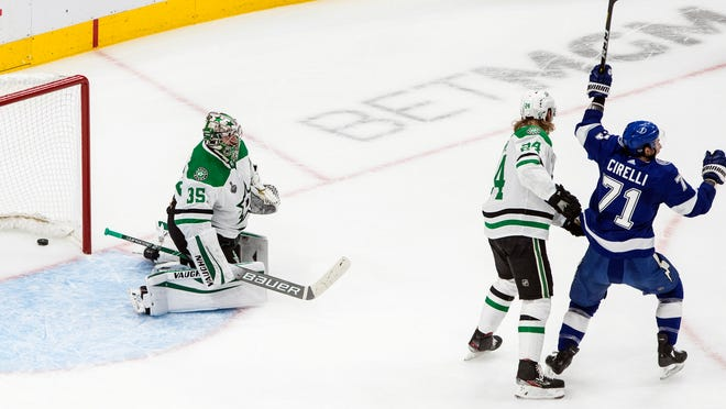 Stars goalie Anton Khudobin is scored against as the Lightning's Anthony Cirelli (71) reacts and the Stars' Roope Hintz (24) defends during Monday's first period of Game 2 of the Stanley Cup Finals.