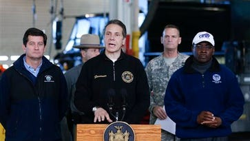 New York Gov. Andrew Cuomo, center, and Erie County Executive Mark Poloncarz, left, and Buffalo Mayor Byron Brown give storm update after lake-effect snowstorms covered the western New York on Friday, Nov. 21, 2014, in Cheektowaga, N.Y.