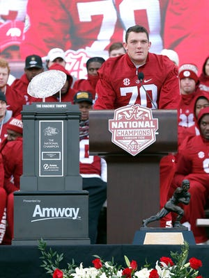 Jan 23, 2016; Tuscaloosa, AL, USA; Alabama offensive lineman Ryan Kelly (70) speaks to fans during a presentation to celebrate the victory in the CFP National Championship game at Bryant-Denny Stadium. Mandatory Credit: Butch Dill-USA TODAY Sports