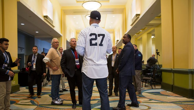 New Yankee Giancarlo Stanton answers questions for members of the media during the Major League Baseball winter meetings in Orlando, Fla., Monday, Dec. 11, 2017.