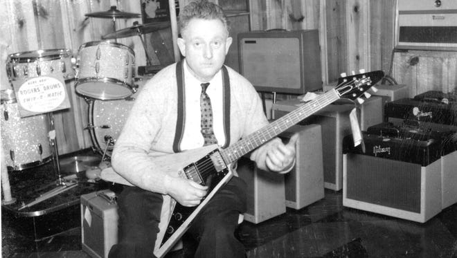 Former Indianapolis music store owner Amos Arthur plays a 1958 Gibson Flying V guitar that he ordered in 1958 and sold the following year.