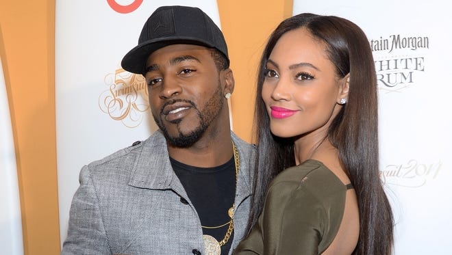 Model Ariel Meredith and American football player Hakeem Nicks attend the 2014 Sports Illustrated Swimsuit 50th Anniversary Issue kick off event at Swimsuit Beach House on Feb. 18, 2014 in New York.