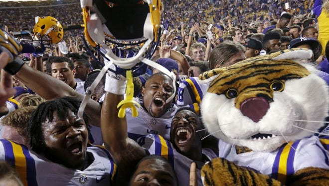 LSU celebrates its 10-7 win last week over then No. 3-ranked Ole Miss.