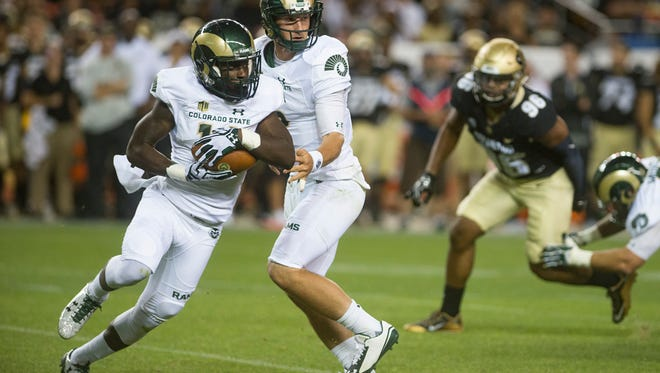 Receiver Anthony Hawkins, one of six true freshmen to see action in CSU's first two games, takes a handoff from quarterback Faton Bauta in the Sept. 2 opener against the University of Colorado.