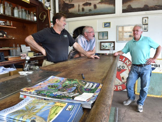 "Pat Martin (from right), owner of Diamond Transfer & Garage at the corner of Bridge Road and A1A, and his friends John Culpepper and Michael Ennis, hang out at Martin's Garage filled with antiques on Tuesday, May 29, 2018, and are supportive of the Hobe Sound incorporation movement. ""I just love how neighborly the town is,"" Culpepper said. To see more photos, go to TCPalm.com. CQ:"