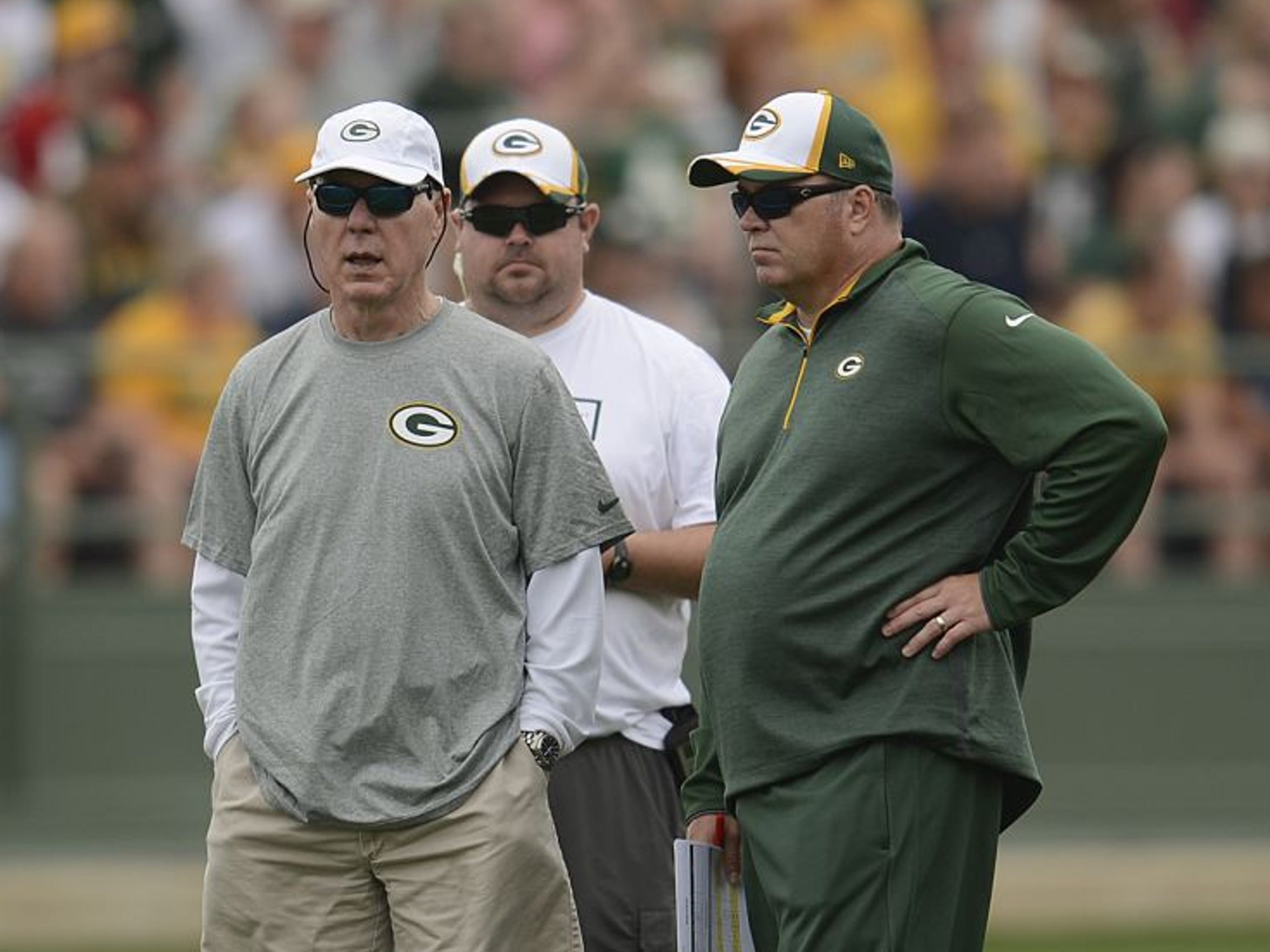 Green Bay Packers general manager Ted Thompson (left)