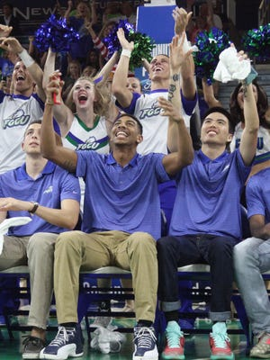 Julian DeBose, center, along with other members of the FGCU men's basketball team react after finding out they will play Fairleigh Dickinson in the NCAA tournament on Tuesday in Dayton, Ohio.