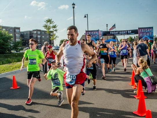 Runners take off at the first-ever Friday Night 5K