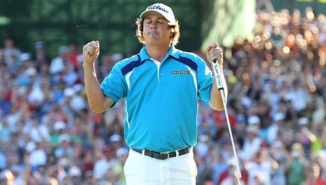 Jason Dufner celebrates his win at the 95th PGA Championship at Oak Hill Sunday.