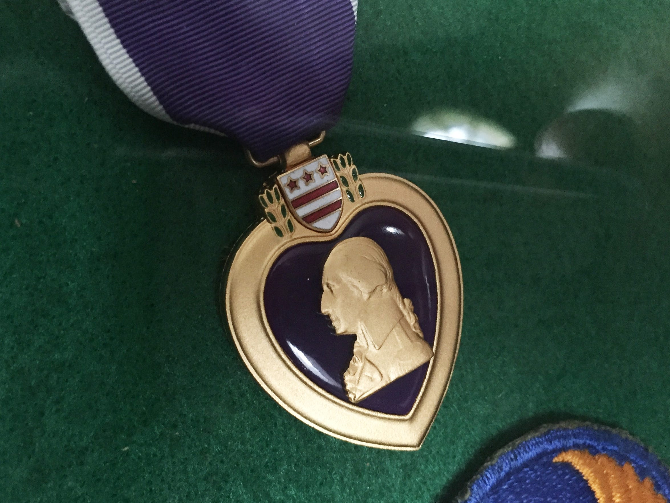 The purple heart awarded to Charles Holcomb.