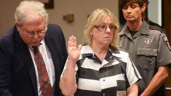 """In this July 28, 2015, file photo, Joyce Mitchell raises her hand during a court appearance in Plattsburgh. Mitchell, the former New York prison employee who helped two killers escape from a maximum-security prison in June, said in an interview that aired Sept. 14, on NBC's """"Today"""" show that she was depressed at the time and the inmates took advantage of what she called her """"weakness."""""""
