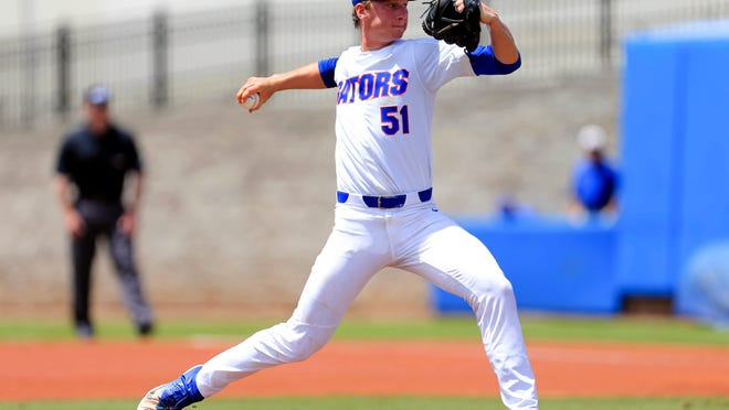 Brady Singer throws a pitch during his playing days at Florida. He is the Kansas City Royals' top prospect.