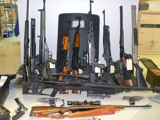 A Fond du Lac Police Department photo of the cache of weapons allegedly confiscated from Shannon Rogler's apartment at The Elms of Fond du Lac, 871 S. Main St., on Dec. 9, 2013. According to police, Rogler fired 26 rounds from two high-powered rifles.