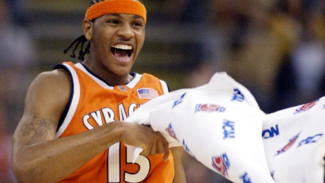 Carmelo Anthony celebrates during the first half against Kansas as the Orange built a 17-point lead in the NCAA title game.