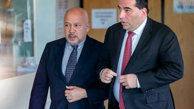 Paterson Mayor Joey Torres, left, turns himself in at the New Jersey State Police barracks in Totowa in March.