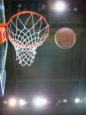 Olivet High School's Colin Grady made an 80-foot basket Feb. 10.