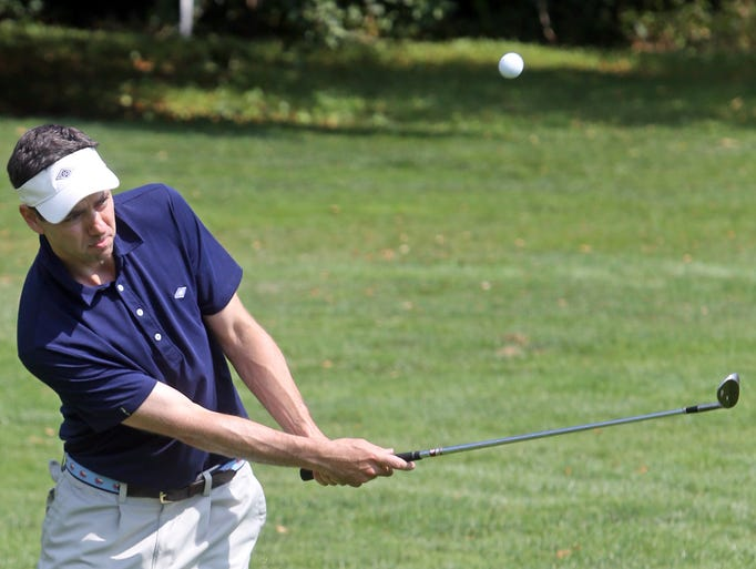 Mike Eglit of Westchester Country Club chips on to the 11th green Club during the 71st. Annual Hoffhine Memorial tournament at Westchester Country Club in Harrison July 31, 2014.