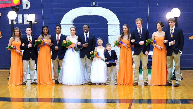 2014-15 DCHS Coming Home basketball court, from left: Freshman attendant Georgia Lawson escorted by Dalton Rainey. Junior attendant Yasmine Daniel escorted by Robert Triggs. Queen Ivy Cummings and King Tyreik Primm. Little attendant Layla Downs escorted by Dylan Cathey. Senior attendant McKenzie Wallace escorted by Ty Murphree. Sophomore attendant Evy Vandivort escorted by Enoch Williams.