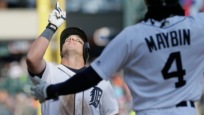 Detroit Tigers' James McCann looks skyward as he approaches home plate after his two-run home run during the seventh inning.