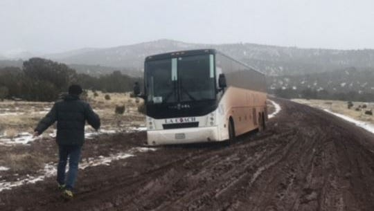 Officials say 44 Korean tourists were stranded for eight hours Monday after their tour bus became stuck in the mud in northern Arizona after the driver tried to take a detour in a snowstorm.