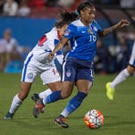 United States forward Crystal Dunn (16) dribbles the