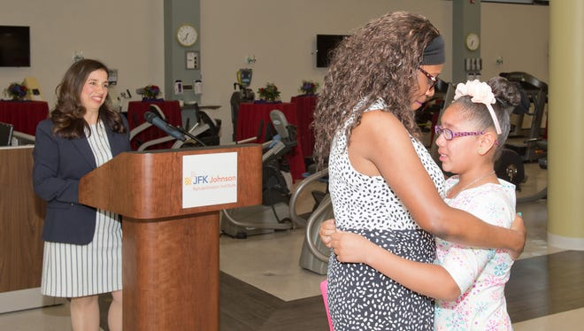 Samantha Taylor of Plainfield with her daughter, Sophia, 11, at the Center for Cardiac and Pulmonary Rehabilitation. Taylor credits the center with helping to save her life.