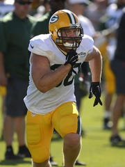 Green Bay Packers fullback John Kuhn during training camp practice at Ray Nitschke Field.