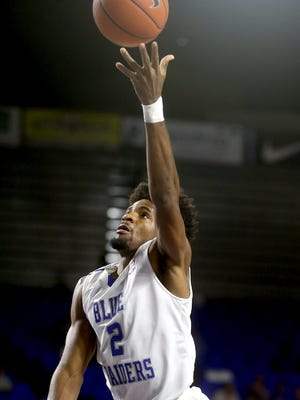 MTSU's Perrin Buford (2) goes up for a shot and is called for charging Faulkner's Monta Sanford (2) during the exhibitio game at MTSU, on Thursday, Nov. 12, 2015.