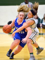 White House senior guard, Lauren Felts attempts to dribble past Greenbrier junior Caitlin Turner during first-half action. Felts scored six points in the Lady Devils' 62-33 loss on Friday evening.