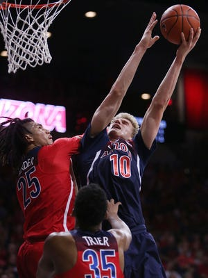Arizona's Lauri Markkanen (10) goes up for a shot during Friday night's scrimmage in Tucson.