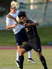 La Quinta sophomore Lucas Rosales (24, white) battles with Sunny Hills player Ricardo Sanchez (11, black) for a loose header in the second half of the Blackhawks' 1-0 CIF semifinal playoff win on Tuesday afternoon, March 3, 2015 at La Quinta.