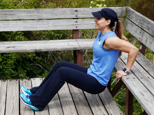 Catherine Andersen shows the triceps dip exercise.