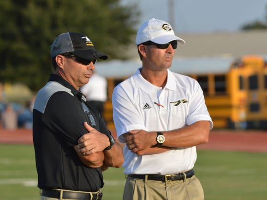 Comanche coach Brent Hermesmeyer (right) and Cisco's Brent West chat before a game on Fri., Sept. 15, 2017 in Comanche. Hermesmeyer, who has build it successful program at Comanche behind the old-fashioned Wing-T offense, has earned the respect of his peers.