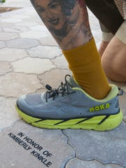 Al Kinkle, displays a tattoo of he wears on his left