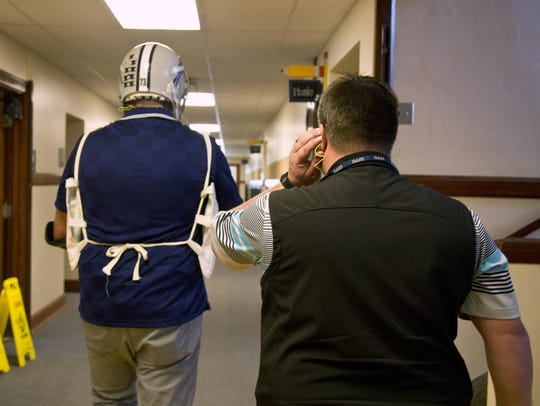 Nick Taylor, left, and Cory Reeves, walk down a Whittier