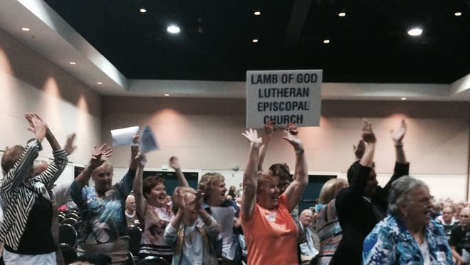 Lamb of God Lutheran Episcopal Church members cheer during roll call during the Lee Interfaith For Empowerment Nehemiah Action Assembly in 2015 at Harborside Event Center in Fort Myers.