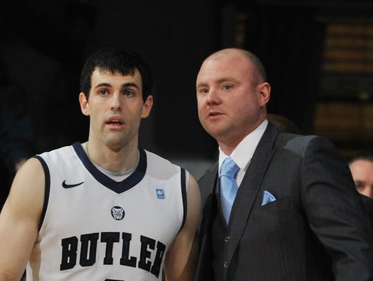 Michael Lewis (center) coached under Brad Stevens and Chris Holtman at Butler. He's also coached for Bob Knight and currently is on Tim Miles' staff at Nebraska.