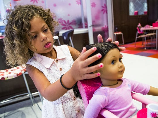 Jaelyn Kangas, 4, of Scottsdale, fixes the hair of