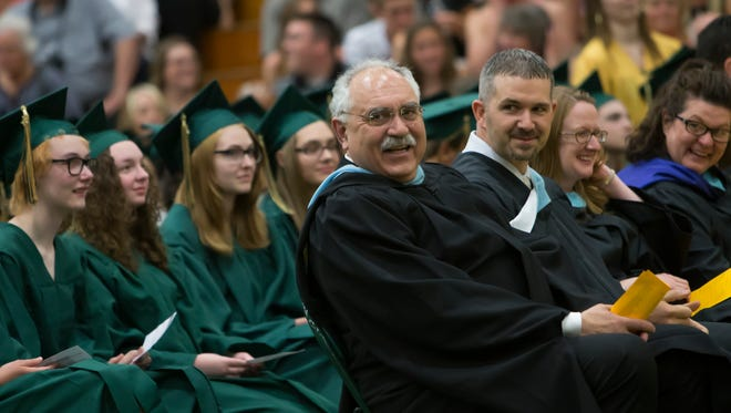 Oshkosh Area School Superintendent Stan Mack II, center, takes part in Oshkosh North High School's commencement ceremony in this 2015 file photo.