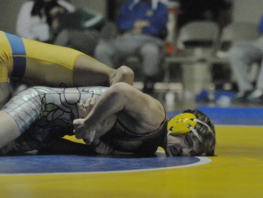 Cape Henlopen's Justin Wright grits his teeth to hold