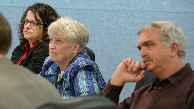 Richmond Community Schools board members Suzanne Derengowski, left, Susan Hively and  Jeff Slifer listen during a Feb. 24 meeting. The board is interviewing candidates to replace Hively.