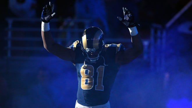 St. Louis Rams wide receiver Kenny Britt (81) puts his hands up to show support for Michael Brown before a game against the Oakland Raiders at the Edward Jones Dome.
