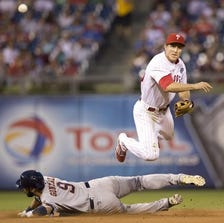 PHILADELPHIA, PA - AUGUST 7: Second baseman Chase Utley #26 of the Philadelphia Phillies attempts to turn a double play as Marwin Gonzalez #9 of the Houston Astros slides in at second base in the top of the fourth inning on August 7, 2014 at Citizens Bank Park in Philadelphia, Pennsylvania. (Photo by Mitchell Leff/Getty Images)