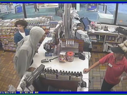 The male in the blue jacket is wanted for questioning