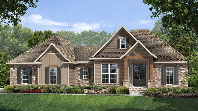Here's a small home with tons of curb appeal, thanks to an interesting roofline, a mix of materials, and an eye-catching truss over the entry.