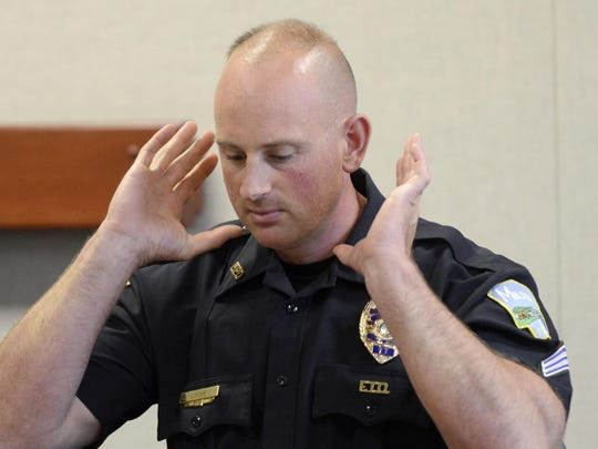 Milton police Sgt. Paul Lock describes a neck brace Gingras wore in the hospital after emergency crews responded to reports of a fire at a Georgia Mountain camp in June, 2014.