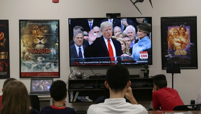 Students of Dan Jones' social studies and language arts class at the Richland School of Academic Arts watch Donald Trump's presidential inauguration.