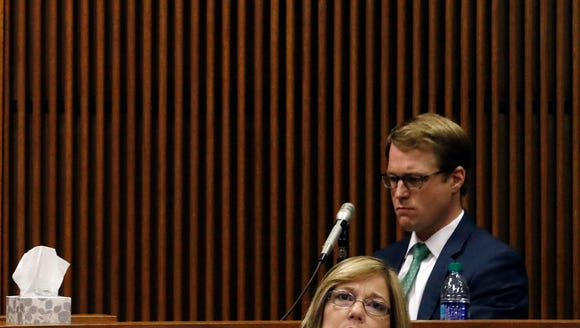 Josh Blades waits on the stand during questioning during